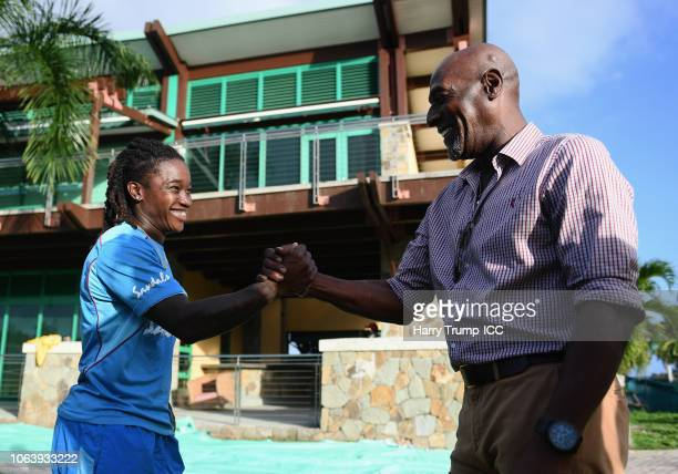 Deandra Dottin of West Indies shakes hands with Sir Vivian Richards during a West Indies Net Session at Coolidge Cricket Ground on November 20, 2018...