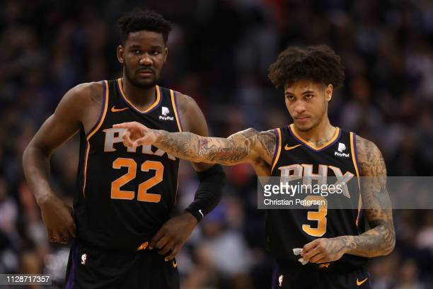 Deandre Ayton and Kelly Oubre Jr #3 of the Phoenix Suns during the second half of the NBA game against the Golden State Warriors at Talking Stick...