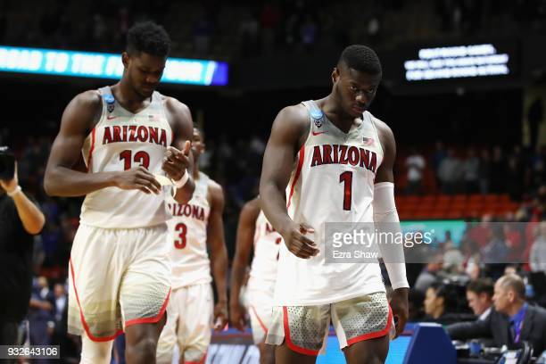 Deandre Ayton and Rawle Alkins of the Arizona Wildcats leave the court after being defeated by the Buffalo Bulls 8968 during the first round of the...