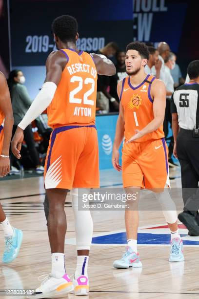 Deandre Ayton highfives Devin Booker of the Phoenix Suns during the game on August 13 2020 at AdventHealth Arena in Orlando Florida NOTE TO USER User...
