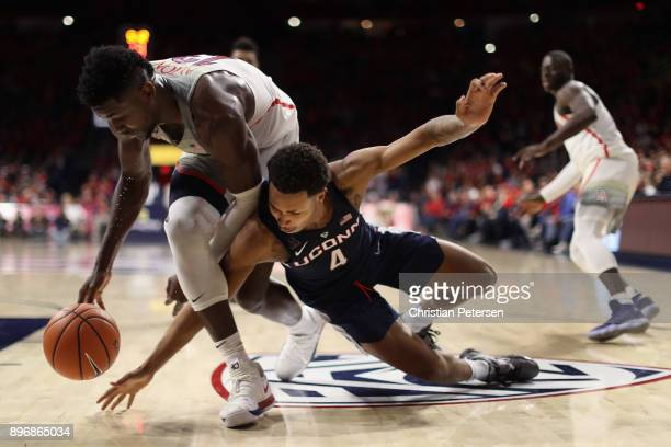 Deandre Ayton of the Arizona Wildcats and Jalen Adams of the Connecticut Huskies attempt to control a loose ball during the second half of the...