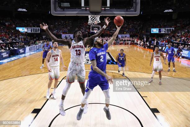 Deandre Ayton of the Arizona Wildcats and Jeremy Harris of the Buffalo Bulls battle for the ball during the first round of the 2018 NCAA Men's...