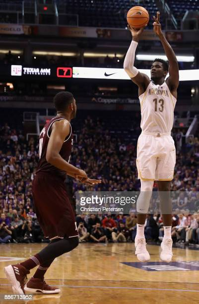 Deandre Ayton of the Arizona Wildcats attempts a shot against the Texas AM Aggies during the second half of the college basketball game at Talking...