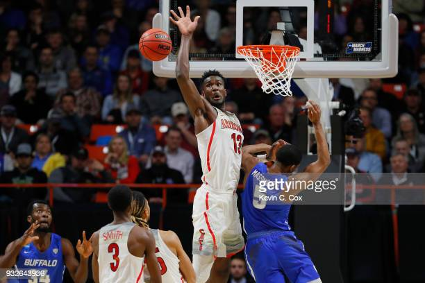 Deandre Ayton of the Arizona Wildcats battles for the ball against CJ Massinburg of the Buffalo Bulls in the second half during the first round of...