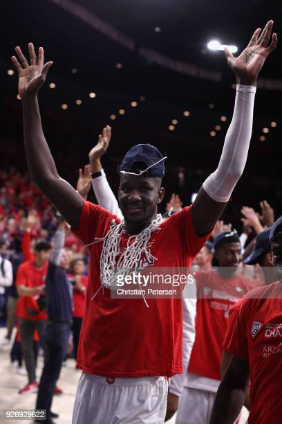 Deandre Ayton of the Arizona Wildcats celebrates after defeating the California Golden Bears 6654 to win the PAC12 Championship at McKale Center on...