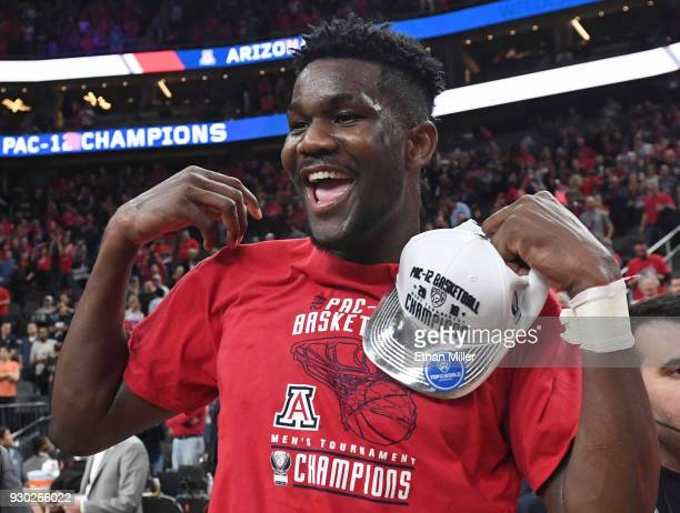 Deandre Ayton of the Arizona Wildcats celebrates after the team defeated the USC Trojans 7561 to win the championship game of the Pac12 basketball...