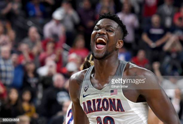 Deandre Ayton of the Arizona Wildcats celebrates on the court after the team defeated the USC Trojans 7561 to win the championship game of the Pac12...