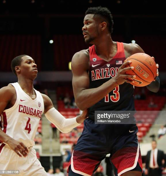 Deandre Ayton of the Arizona Wildcats controls the ball against Viont'e Daniels of the Washington State Cougars in the first half at Beasley Coliseum...