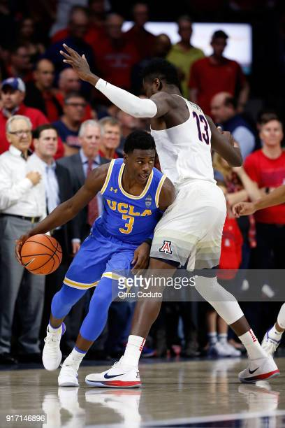 Deandre Ayton of the Arizona Wildcats defends Aaron Holiday of the UCLA Bruins during the second half of the college basketball game at McKale Center...
