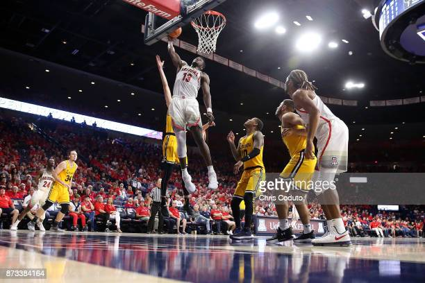 Deandre Ayton of the Arizona Wildcats dunks during the second half of the college basketball game against the UMBC Retrievers at McKale Center on...