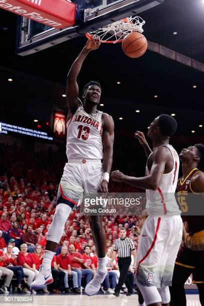 Deandre Ayton of the Arizona Wildcats dunks during the second half of the college basketball game against the Arizona State Sun Devils at McKale...