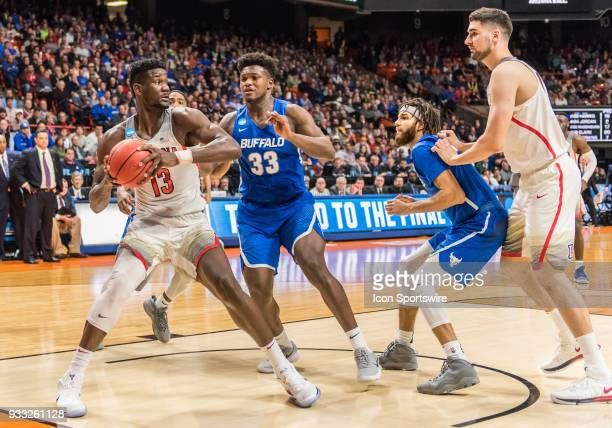 DeAndre Ayton of the Arizona Wildcats gets pressure from F Nick Perkins of the Buffalo Bulls during the NCAA Division I Men's Championship First...