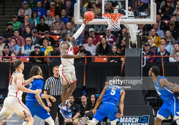 DeAndre Ayton of the Arizona Wildcats goes for a lay up during the NCAA Division I Men's Championship First Round game between the Arizona Wildcats...