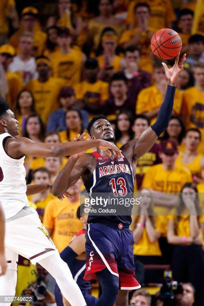 Deandre Ayton of the Arizona Wildcats grabs a pass over De'Quon Lake of the Arizona State Sun Devils during the second half of the college basketball...