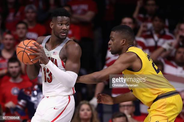 Deandre Ayton of the Arizona Wildcats handles the ball against Kingsley Okoroh of the California Golden Bears during the first half of the college...