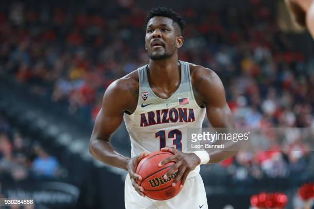 Deandre Ayton of the Arizona Wildcats handles the ball against the USC Trojans during the championship game of the Pac12 basketball tournament at...