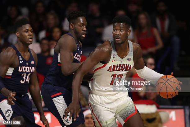 Deandre Ayton of the Arizona Wildcats handles the ball during the second half of the college basketball game against the Connecticut Huskies at...