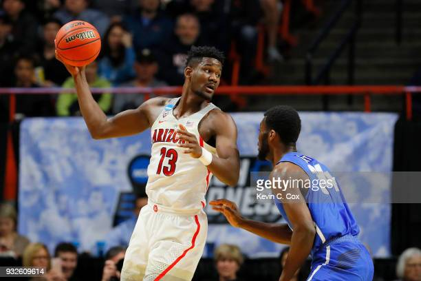 Deandre Ayton of the Arizona Wildcats handles the ball in the first half against Ikenna Smart of the Buffalo Bulls during the first round of the 2018...