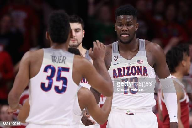 Deandre Ayton of the Arizona Wildcats high fives Allonzo Trier after scoring against the Alabama Crimson Tide during the first half of the college...