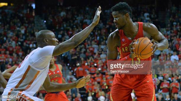 Deandre Ayton of the Arizona Wildcats looks to dirve against Cheickna Dembele of the UNLV Rebels during their game at the Thomas Mack Center on...