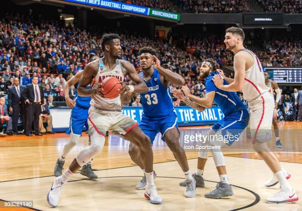DeAndre Ayton of the Arizona Wildcats looks to move an inbound pass during the NCAA Division I Men's Championship First Round game between the...