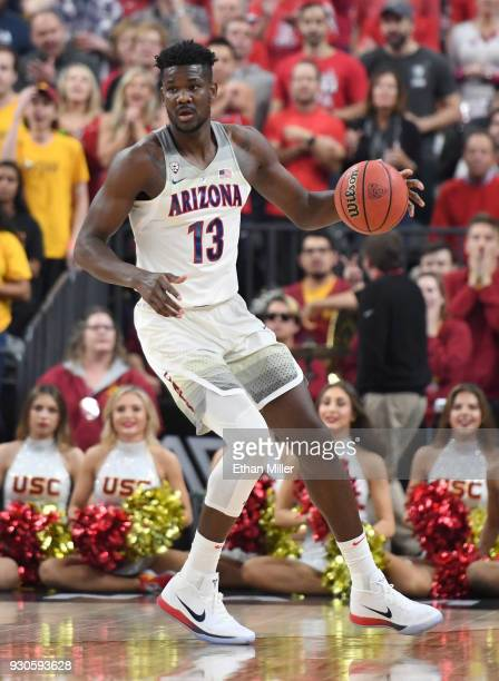 Deandre Ayton of the Arizona Wildcats looks to pass against the USC Trojans during the championship game of the Pac12 basketball tournament at...
