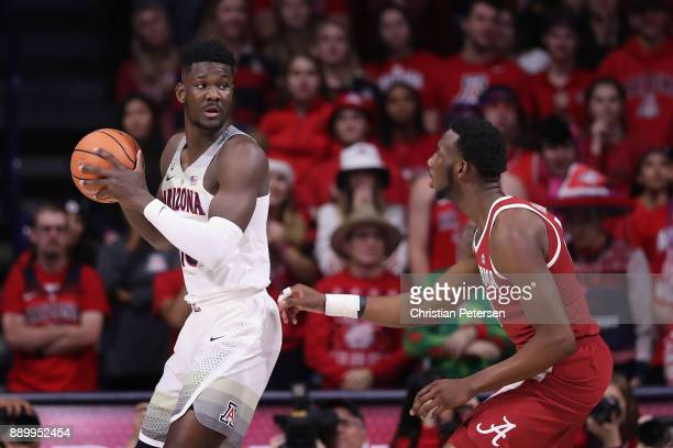 Deandre Ayton of the Arizona Wildcats looks to pass around Donta Hall of the Alabama Crimson Tide during the first half of the college basketball...