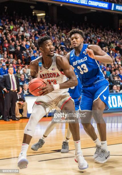 DeAndre Ayton of the Arizona Wildcats moves the ball along the baseline during the NCAA Division I Men's Championship First Round game between the...