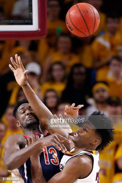 Deandre Ayton of the Arizona Wildcats passes over De'Quon Lake of the Arizona State Sun Devils during the second half of the college basketball game...