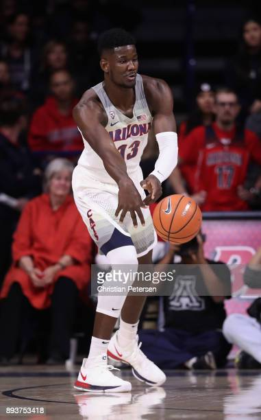 Deandre Ayton of the Arizona Wildcats passes the ball during the first half of the college basketball game against the Alabama Crimson Tide at McKale...