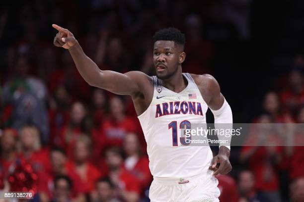 Deandre Ayton of the Arizona Wildcats points down court after scoring against the Alabama Crimson Tide during the first half of the college...