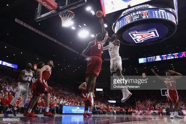 Deandre Ayton of the Arizona Wildcats puts up a shot over Donta Hall of the Alabama Crimson Tide during the second half of the college basketball...