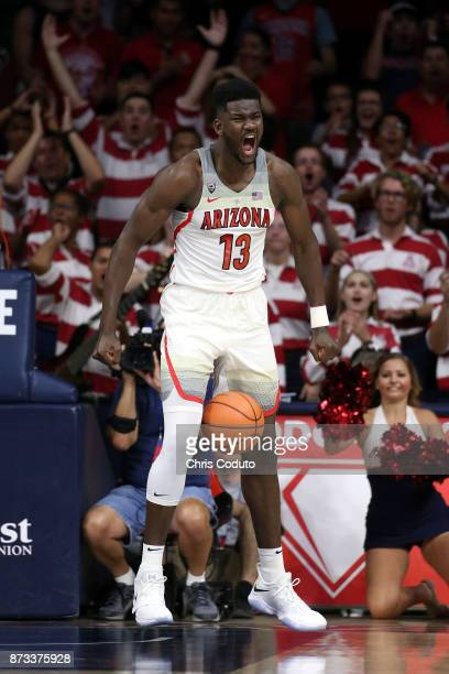 Deandre Ayton of the Arizona Wildcats reacts after a dunk during the first half of the college basketball game UMBC Retrievers at McKale Center on...