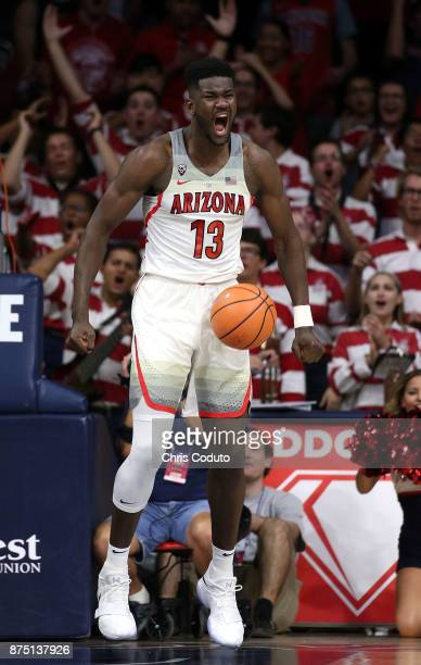 Deandre Ayton of the Arizona Wildcats reacts after a dunk during the first half of the college basketball game against the UMBC Retrievers at McKale...