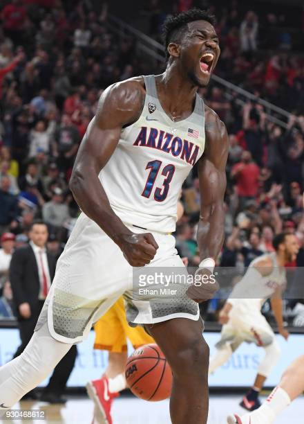 Deandre Ayton of the Arizona Wildcats reacts after dunking against the USC Trojans during the championship game of the Pac12 basketball tournament at...