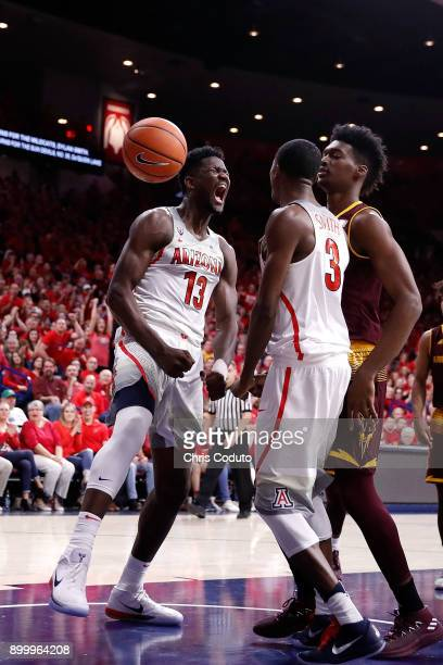 Deandre Ayton of the Arizona Wildcats reacts with teammate Dylan Smith after scoring a basket during the second half of the college basketball game...
