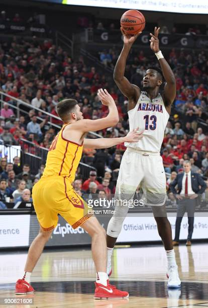 Deandre Ayton of the Arizona Wildcats shoots against Nick Rakocevic of the USC Trojans during the championship game of the Pac12 basketball...