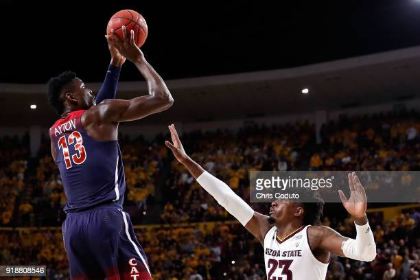 Deandre Ayton of the Arizona Wildcats shoots over Romello White of the Arizona State Sun Devils during the first half of the college basketball game...