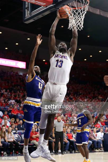 Deandre Ayton of the Arizona Wildcats shoots over Shon Briggs of the Cal State Bakersfield Roadrunners during the second half of the college...