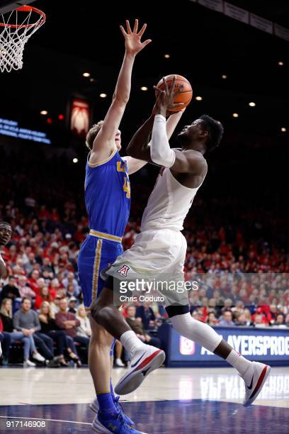 Deandre Ayton of the Arizona Wildcats shoots over Thomas Welsh of the UCLA Bruins during the second half of the college basketball game at McKale...
