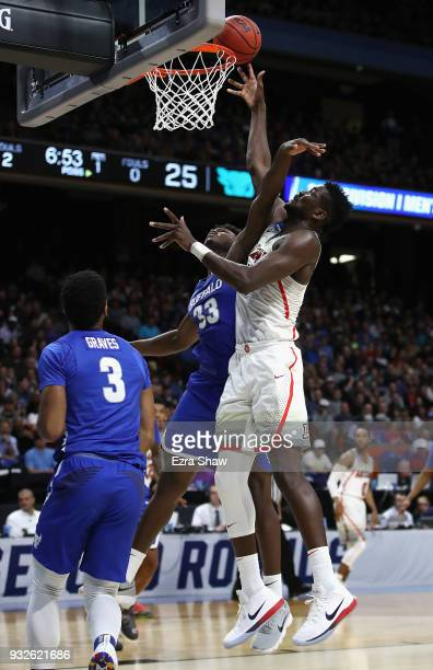 Deandre Ayton of the Arizona Wildcats shoots the ball against Nick Perkins of the Buffalo Bulls in the first half during the first round of the 2018...