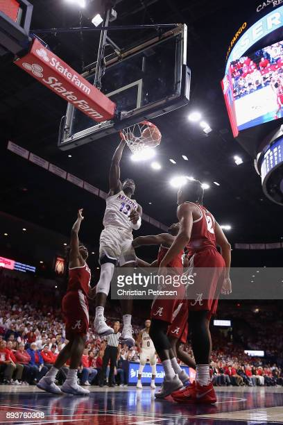 Deandre Ayton of the Arizona Wildcats slam dunks against the Alabama Crimson Tide during the second half of the college basketball game at McKale...