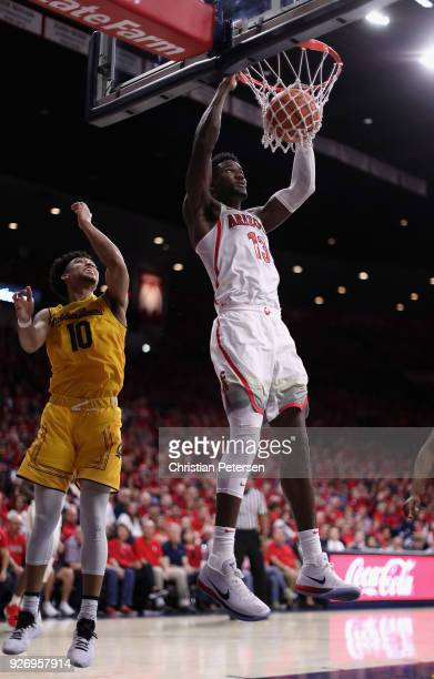 Deandre Ayton of the Arizona Wildcats slam dunks the ball against the California Golden Bears during the second half of the college basketball game...