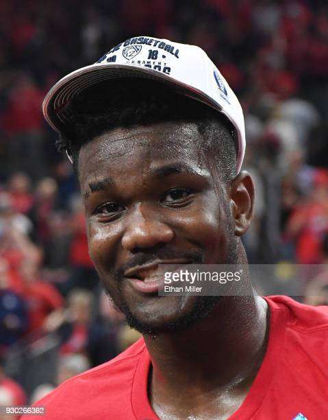 Deandre Ayton of the Arizona Wildcats smiles on the court after the team defeated the USC Trojans 7561 to win the championship game of the Pac12...