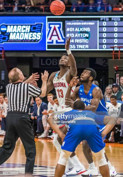DeAndre Ayton of the Arizona Wildcats take the game starting jump shot over F Gabe Agorioge of the Buffalo Bulls at the first round playoffs between...