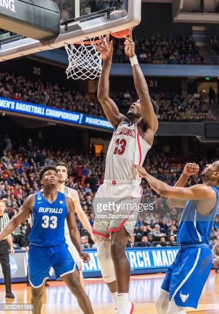 DeAndre Ayton of the Arizona Wildcats tips up the ball for a basket during the NCAA Division I Men's Championship First Round game between the...