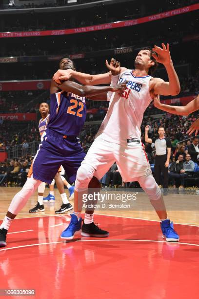 Deandre Ayton of the Phoenix Suns and Boban Marjanovic of the LA Clippers fight for position on November 28 2018 at STAPLES Center in Los Angeles...