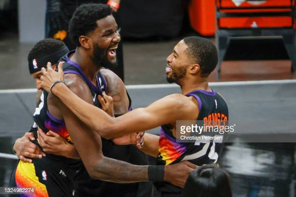 Deandre Ayton of the Phoenix Suns and Mikal Bridges celebrate defeating the LA Clippers 104-103 in game two of the NBA Western Conference finals at...