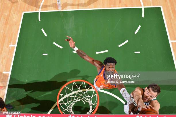 Deandre Ayton of the Phoenix Suns and Pat Connaughton of the Milwaukee Bucks fight for the rebound during Game Four of the 2021 NBA Finals on July...