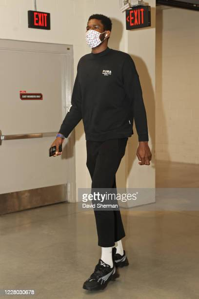Deandre Ayton of the Phoenix Suns arrives to the arena before the game against the Dallas Mavericks on August 13 2020 in Orlando Florida at...